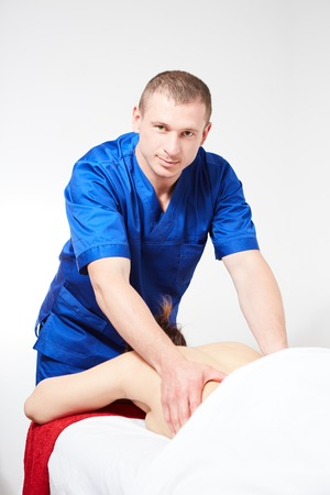 The young woman having back massage in spa salon