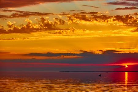darken: The good red sunset over darken sea.