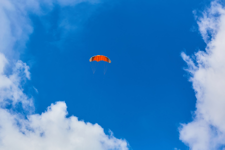 Orange kite in the sky and cloud