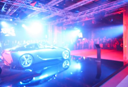 Blurred defocused image of car presentation Archivio Fotografico