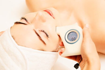 Skin Care. Beautiful Healthy Woman Getting Her Skin Analized By Cosmetologist, Using Skin Analyzer. Professional Beauty Equipment. For Face Skin Analysis At Cosmetology Center