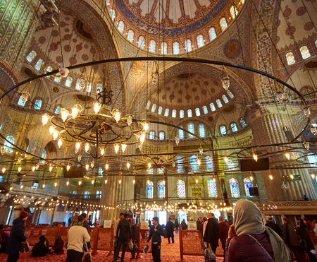 Istanbul, Turkey - 1 April, 2017: Interior of blue Mosque also called Sultan Ahmed Mosque or Sultan Ahmet Mosque in Istanbul, Turkey.Ceiling decorations with Islamic elements of Sultan Ahmed Mosque dome.