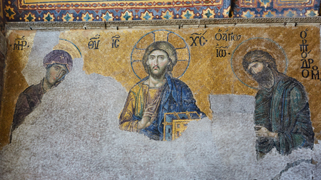 13th century Deesis Mosaic of Jesus Christ, known as Christ Pantocrator, flanked by the Virgin Mary and John the Baptist in the Hagia Sophia temple in Istanbul, Turkey Stock Photo