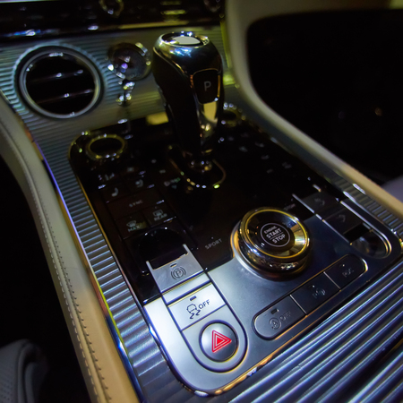 Design details of minimalist concept of modern car - close-up details of automatic transmission and gear stick