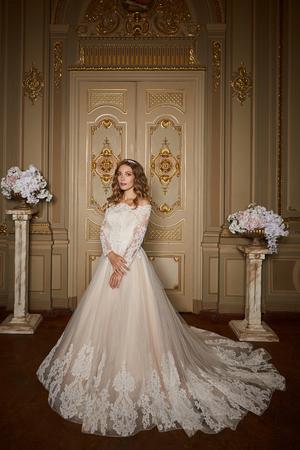 Beautiful bride in luxury baroque interior. Full-length portrait.