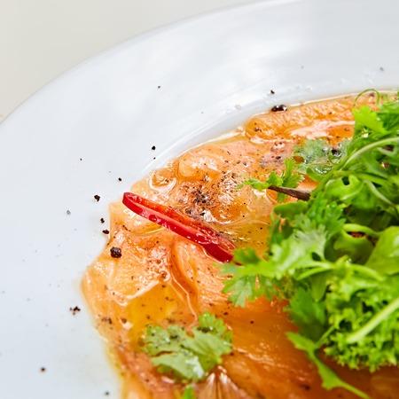 Top view of salmon carpaccio. Shallow dof.