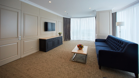 A modern livingroom inside a new flat with TV.