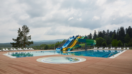swimming pool on luxury resort in forest. 스톡 콘텐츠