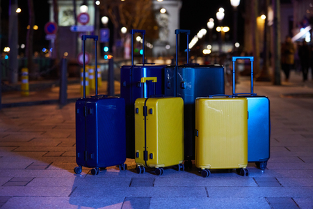Luggage consisting of six polycarbonate suitcases standing on the street Stok Fotoğraf