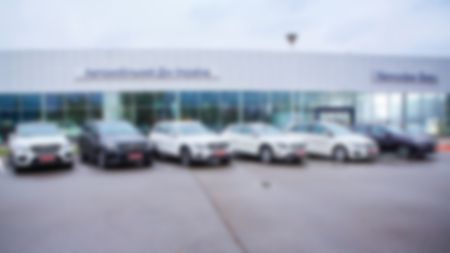 Abstract blurred photo of motor show, car show room,