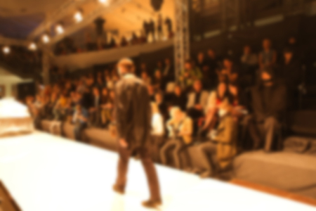 Fashion runway out of focus. The blur background Imagens