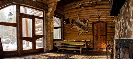 country style interior in hunter chalet with fireplace Stock Photo