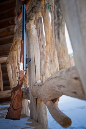 hunting rifle on the terrace of the lodge. Stock fotó