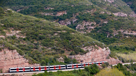 The train in mountain near Santa Maria de Montserrat Abbey.