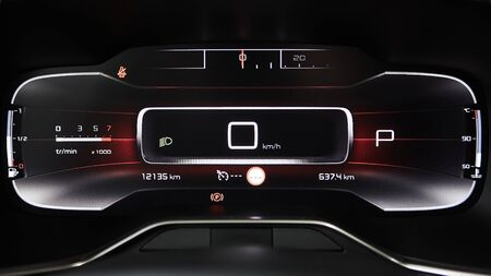 Car dashboard panel with speedometer, tachometer, odometer, fuel gauge and gear position indicator.