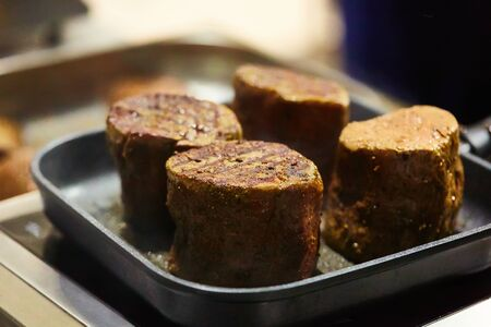 The beef steak in a frying pan. Shallow dof