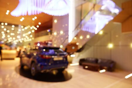 Blurred, defocused background of public event exhibition hall showing cars and automobiles Stok Fotoğraf
