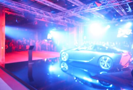 The blurred defocused image of car presentation.