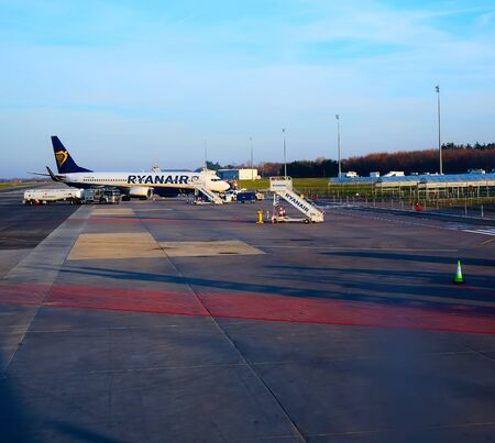 Modlin, Poland - November 17, 2019: Preparing for boarding to Ryanair plane in Warsaw Modlin airport in Poland. Ryanair operates over 300 aircraft and is the biggest low-cost airline company in Europe.