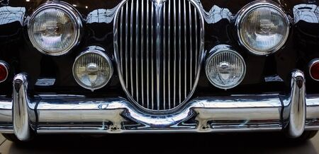 Detail of classic car. Close-up of headlight.
