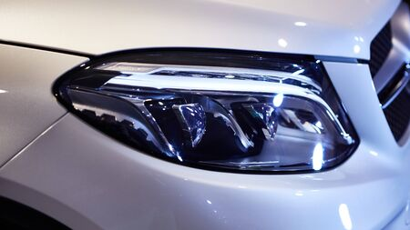 Close up headlights of car. Shallow dof.