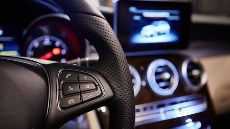 The cars multifunction steering wheel. Interior shot.