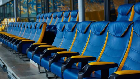 blue chair on sport stadium Imagens