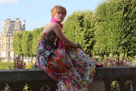 Beautiful young Parisian woman posing in Tuileries Garden