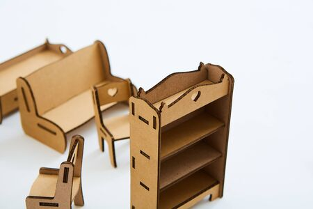 Dollhouse furniture from cardboard. Concept of Circular economy.