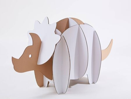 Dinosaur Triceratops made of cardboard. Idea for the birthday party, dino party or photo session
