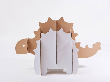 Dinosaur Ankylosaurus made of cardboard. Idea for the birthday party, dino party or photo session