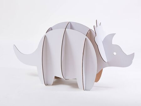 Dinosaur Triceratops made of cardboard. Idea for the birthday party, dino party or photo session. Stok Fotoğraf