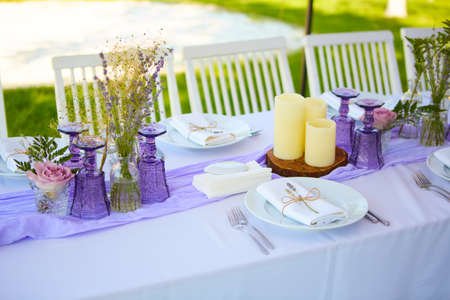 Table set for wedding or another catered event dinner. Shallow dof