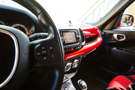 Modern black steering wheel with multifunction buttons for quick control, close-up in the car. Shallow dof. 版權商用圖片