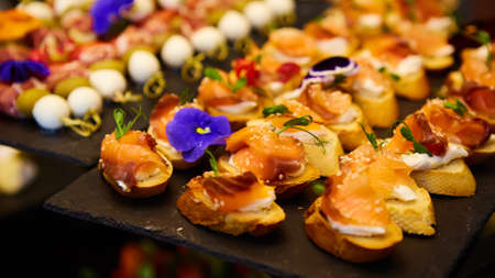 Delicious canapes with smoked salmon. Shallow dof.