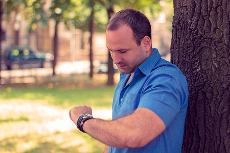 Man looking at his watch Stockfoto