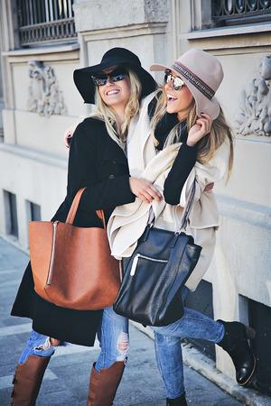 two friends: Girlfriends having fun on the street Stock Photo