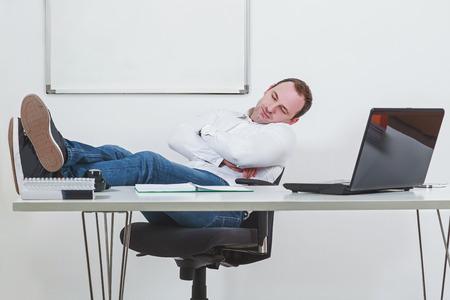 sleep well: Businessman sleeping on the job at work