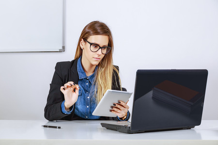 Businesswoman working with digital tablet and laptop photo