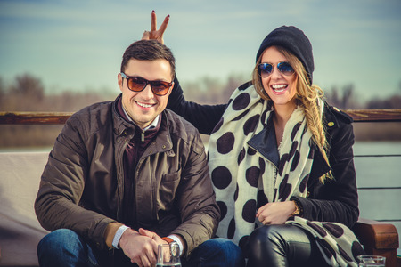 bunny ears: Girl holding bunny ears to her boyfriend Stock Photo
