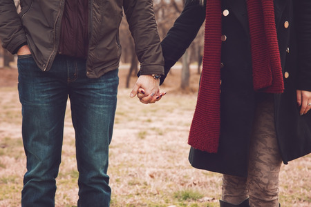Couple in the park holding hands