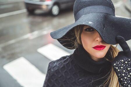 rain coat: Fashionable girl on a rainy day