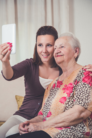 Granddaughter and grandmother taking selfie