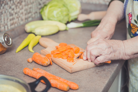 Grandmother cutting vegetables