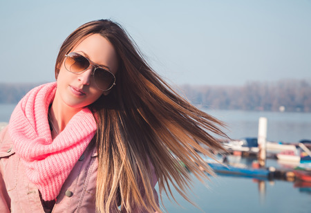 Brunette girl with wind in her hair photo