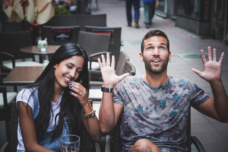 Playful couple laughing in a bar Standard-Bild