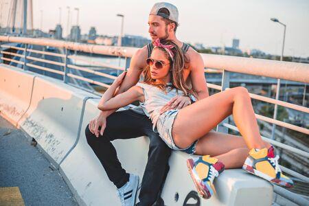 women in jeans: Fashionable Couple lying on the bridge