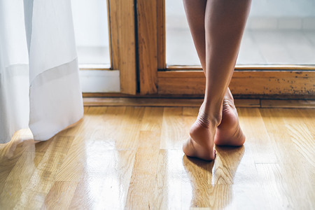barefoot girls: legs of a elegant and barefoot girl Stock Photo
