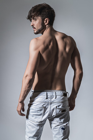 Muscled back of a fit man. Studio