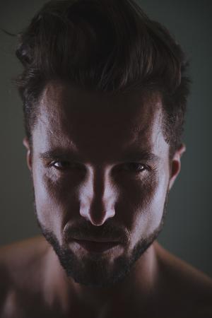 tough: Tough man looking at you. Studio
